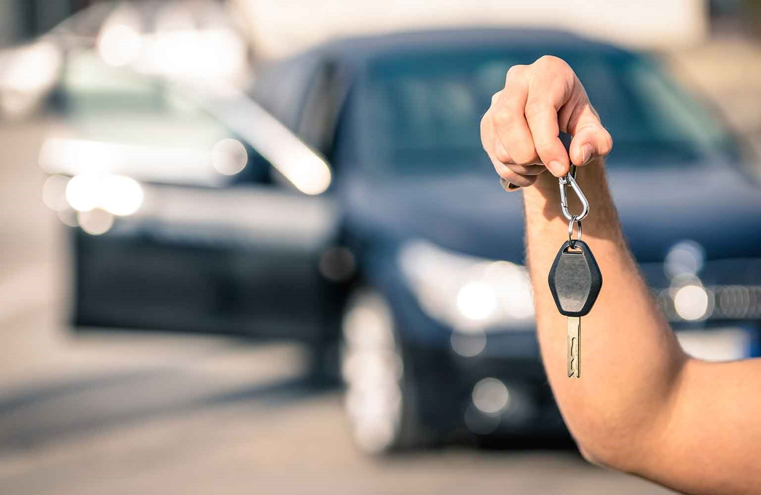 Picture of a man holding car key
